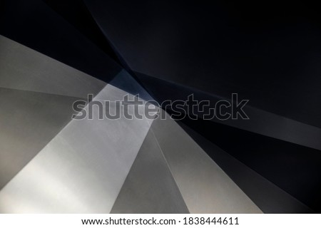 Metal panels. Steel sheets resembling abstract modern architecture exterior or interior detail. Industrial background in hi-tech style. Polygonal or polyhedron geometric pattern.