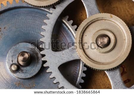 Old gear mechanism with traces of corrosion. Cogwheel retro gear. Metal gear mechanisms.