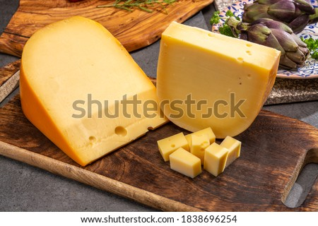 Cheese collection, Dutch ripe hard cheeses made from cow milk in the Netherlands close up Royalty-Free Stock Photo #1838696254