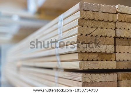 Deck board made of solid wood in a stack. Construction industry. For construction and finishing works. Sale of building materials. Royalty-Free Stock Photo #1838734930