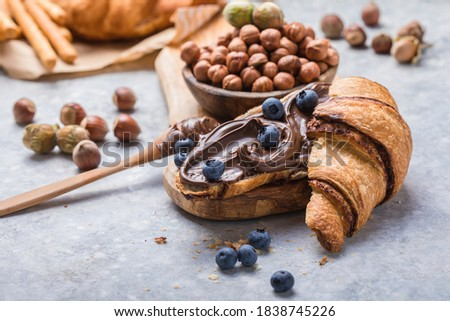 Continental breakfast with croissant, hazelnut chocolate spread and coffee. Royalty-Free Stock Photo #1838745226