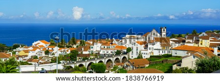 Panorama view of Nordeste on Sao Miguel Island, Azores. Old stone arch bridge in Nordeste village, Sao Miguel, Azores. Nordeste village with white town buildings on the island of Sao Miguel, Portugal. Royalty-Free Stock Photo #1838766919