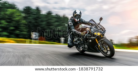 motorbike on the road driving fast. having fun on the empty highway on a motorcycle  journey. copyspace for your individual text. Fast Motion Blur effect #1838791732