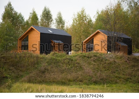 Barnhouse style house. House in the bosom of nature. Greenery and trees. Royalty-Free Stock Photo #1838794246