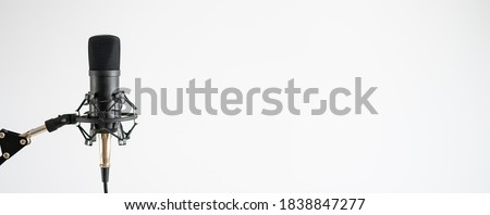 Professional microphone on a white background. Sound recording and broadcasting equipment