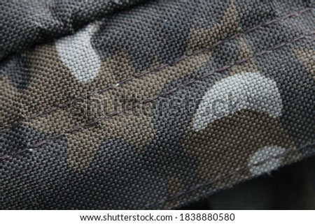 Close up image of army camouflage print on firm material. Background wallpaper layer for graphic and web design purposes.  #1838880580