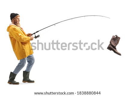 Full length profile shot of a young bearded fisherman with an old boot on a fishing rod isolated on white background Royalty-Free Stock Photo #1838880844