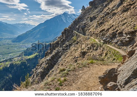 Exposed hiking path in the mountains. Hiking through the mountains in South Tyrol, Italy. Hiking trail in South Tyrol. Hiking through the mountain landscape in South Tyrol, Italy. #1838887096