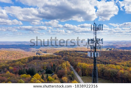 Aerial view of mobiel phone cell tower over forested rural area of West Virginia to illustrate lack of broadband internet service Royalty-Free Stock Photo #1838922316