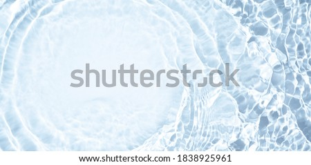 Splash cosmetic moisturizer water micellar toner or emulsion  blue colored abstract background Royalty-Free Stock Photo #1838925961