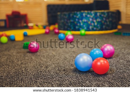 Balloons of different colors lie on the floor as a decoration for a children's party or birthday.
