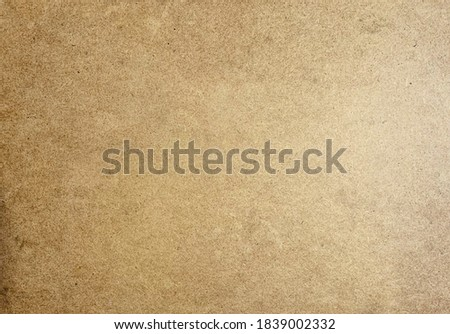Brown fiberboard closeup texture background. Cartoon texture
