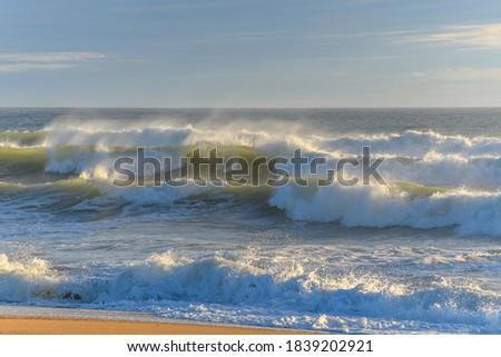 Breaking waves on an Atlantic Ocean beach. Royalty-Free Stock Photo #1839202921