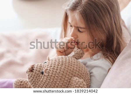 Sick little girl at home Royalty-Free Stock Photo #1839214042
