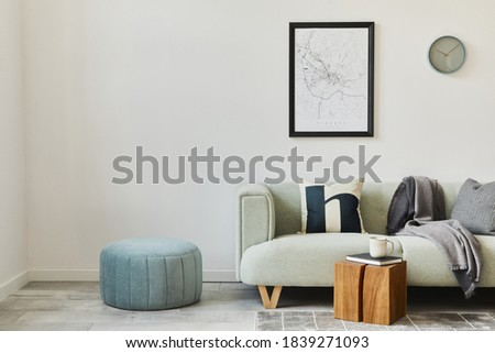 Stylish loft interior with green sofa, design pouf, mock up poster map, furniture,  carpet, plants, decoration and elegant accessories. Modern home decor. Template. Royalty-Free Stock Photo #1839271093