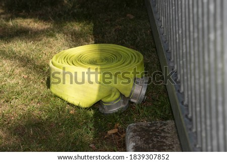 a fire hose to extinguish fires and flames, fire fighting equipment