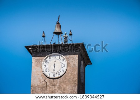 Maurizio's Tower with Bell and Bronze Statue in Orvieto, Italy, a mechanical Clock Tower with Bells and an Automaton Royalty-Free Stock Photo #1839344527