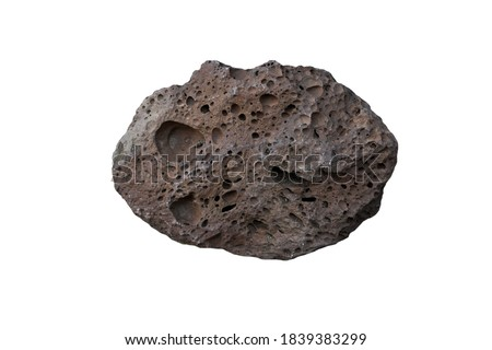 Basalt is an extrusive igneous rock, isolated on white background. Royalty-Free Stock Photo #1839383299