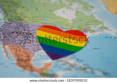 Rainbow color heart on America globe world map background, symbol of LGBT pride month  celebrate annual in June social, symbol of gay, lesbian, gay, bisexual, transgender, human rights and peace.