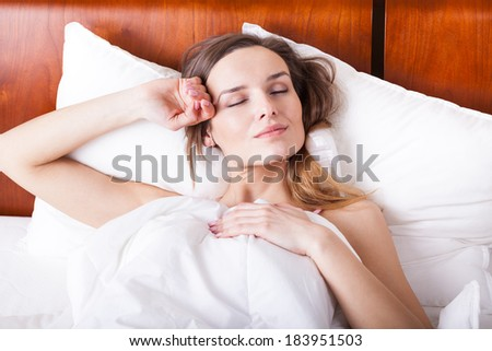 Relax time in bed - sleeping young woman #183951503