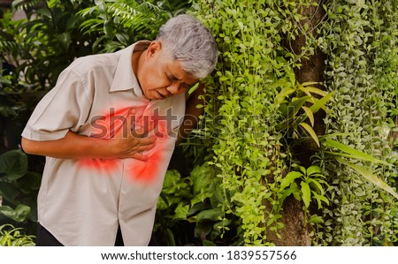 An elderly man is sick with lung disease. I have severe chest pain and shortness of breath, I am walking in the outdoor corridor. Chronic obstructive pulmonary disease : Health care concept Royalty-Free Stock Photo #1839557566