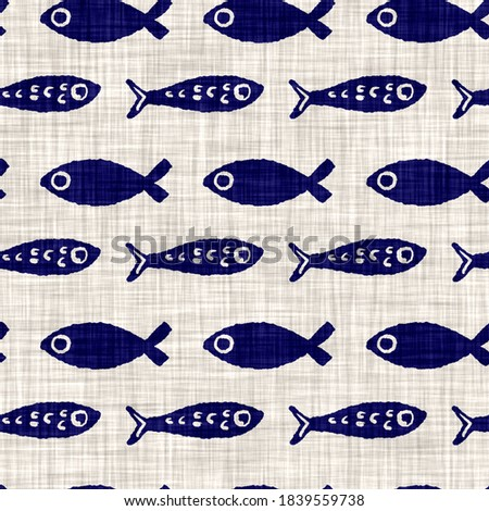 Aquatic blue fishes on cream linen texture background. Summer coastal living style home decor tile. Under the sea life shoal of fish maritime material. Modern mariner textile seamless pattern.