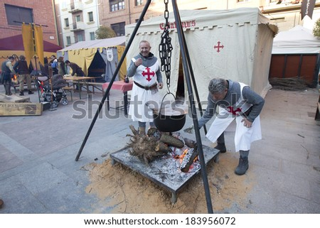 TERUEL, SPAIN - FEBRUARY 22 2014: Participants during rendering of the medieval festival of Bodas de Isabel de Segura recreating the legend of the Lovers of Teruel during the third weekend in February #183956072