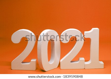Happy new year 2021 , 2021 number wooden object on orange background and copy space - orange new year celebrate concept  #1839590848