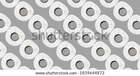 toilet paper pattern on a gray background. the concept of buying toilet paper during the quarantine. space for text