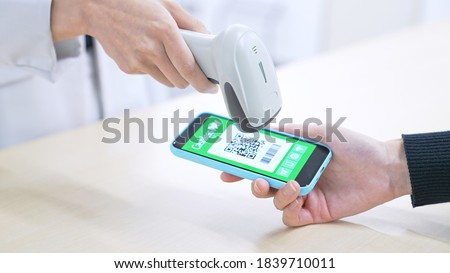 Cashless payment concept. Payment with smartphone app. QR code. Royalty-Free Stock Photo #1839710011