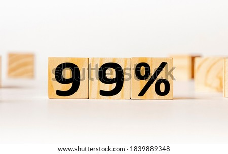 A wooden block with the word 99 percent written on it on a white background. Business concept