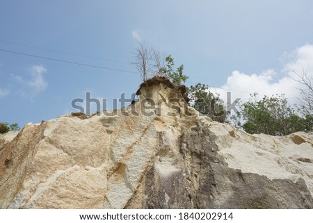 limestone hills, visible limestone mining. benefits of limestone as a mixture of building materials. limestone can also be used as a mixture of substances for fertilizer and pest control. #1840202914