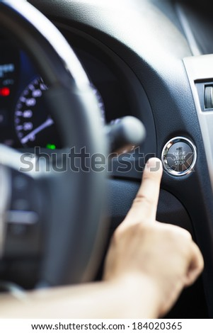 finger pressing the Engine start stop button #184020365
