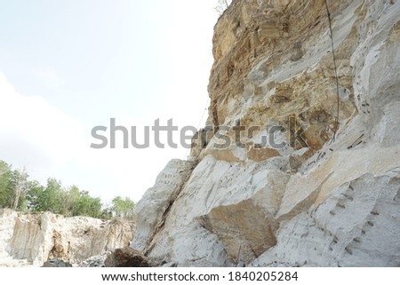 limestone hills, visible limestone mining. benefits of limestone as a mixture of building materials. limestone can also be used as a mixture of substances for fertilizer and pest control #1840205284