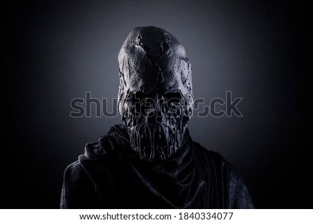 Portrait of a scary zombie in the dark Royalty-Free Stock Photo #1840334077