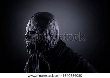 Portrait of a scary zombie in the dark Royalty-Free Stock Photo #1840334080