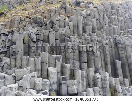 Unique natural basalt rock pillars columns  in Iceland. Geological wonder hexagonal volcanic formations in Vik beach. Royalty-Free Stock Photo #1840351993
