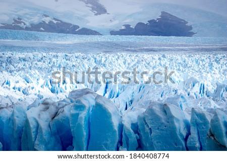 Horizontal view Glacier Perito Moreno national park Los Glaciares. The Argentine Patagonia in Autumn. Royalty-Free Stock Photo #1840408774