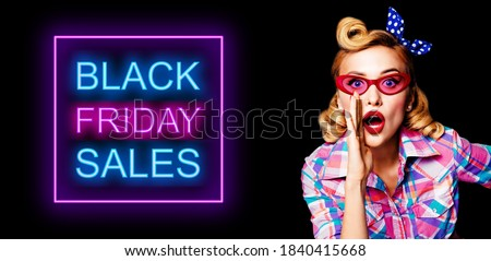 Portrait of beautiful pinup woman in red glasses, holding hand near open mouth and saying something. Blond haired pin up girl at retro vintage studio concept. Black Friday sales neon light sign. #1840415668