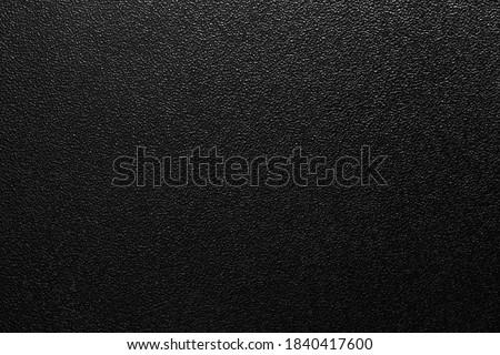 dark background of hammered powder paint coating on flat sheet steel surface Royalty-Free Stock Photo #1840417600