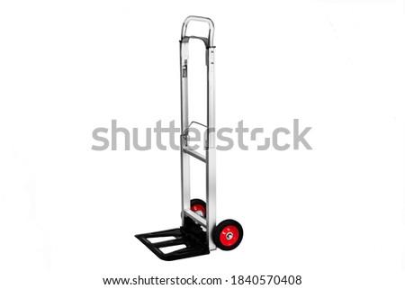 Small trolley cart to transport small things, handcart, cart, pushcart, barrow, wheelbarrow, aluminum cart Royalty-Free Stock Photo #1840570408