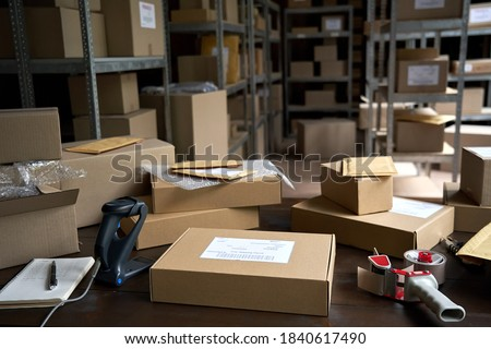 Distribution warehouse background, commercial shipping order boxes for dispatching on stockroom table, post courier delivery package, dropshipping commerce retail store shipment storage concept. #1840617490