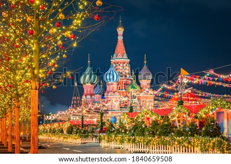 Basil's Sabor in Moscow. Christmas in Russia. Christmas market on the red square. New Year's Eve at the Kremlin walls. St. Basil's Cathedral on a winter night. Tour to Russia. Travel to Moscow. #1840659508