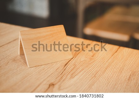 Empty wooden tag for reserved restaurant. Concept of reserved table. A tag of reservation #1840731802