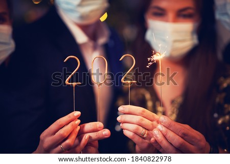 Two beautiful young couples having fun at New Year's Eve Party Royalty-Free Stock Photo #1840822978