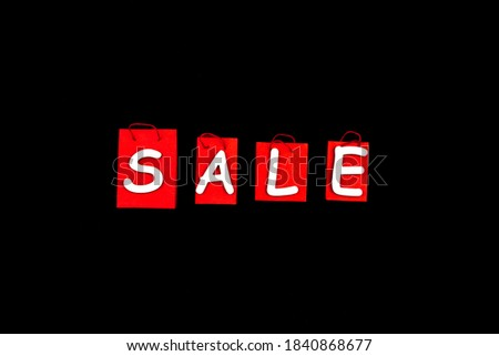 Red paper shopping bags, packs on background canvas. Black friday sale concept. Best deal offer to buy cheap goods, products, technics, clothes, gifts. Seasonal autumn discount. Hot low prices.