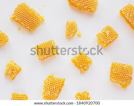 Honeycombs with natural healthy bees wax texture. Top view Royalty-Free Stock Photo #1840920700