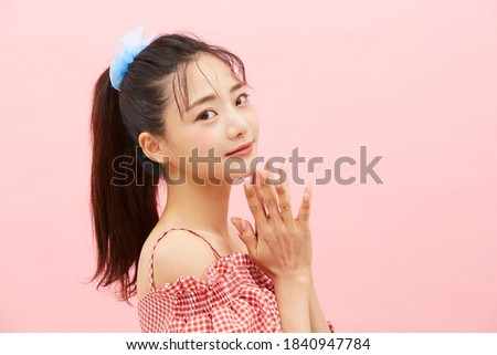Casual beauty concept of pretty Asian girl on pink background Royalty-Free Stock Photo #1840947784