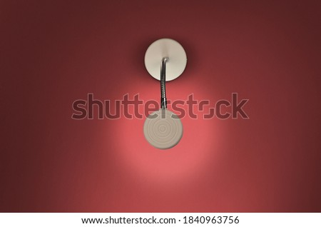 Modern white picture wall lamp on red background