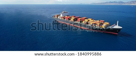 Aerial drone panoramic ultra wide photo of industrial truck size container tanker ship cruising in open ocean deep blue sea